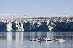 Arctic glacier front in Spitzbergen, Svalbard. Island Norway Royalty Free Stock Images