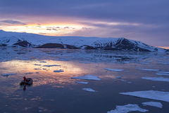 Arctic Glow reflecting in Whalers Bay, Deception Island, Antarct Stock Images