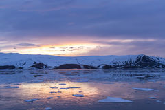 Arctic Glow reflecting in Whalers Bay, Deception Island, Antarct Royalty Free Stock Images