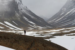 Arctic hike. Hiker on a cloudy day in the Nallo valley, arctic Sweden Stock Image