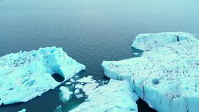 Arctic ice nature landscape of global warming and climate change concept top drone shot footage 4 k. Antarctica melting blue water iceberg aerial view. Antarctic stock video