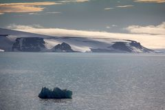 Arctic Islands Glaciers, snowfields, iceberg and rock outcrops. Islands along British channel. Glaciers, icefall, outlet glacier, snowfields, iceberg and rock Stock Photos