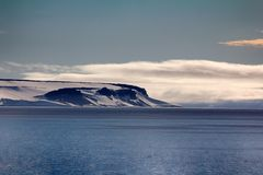 Arctic Islands Glaciers, snowfields and rock outcrops. Islands along British channel. Glaciers, icefall, outlet glacier, snowfields, iceberg and rock outcrops Stock Image