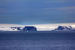 Arctic Islands Glaciers, snowfields and rock outcrops. Islands along British channel. Glaciers, icefall, outlet glacier, snowfields and rock outcrops. Northbrook Royalty Free Stock Images