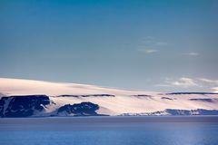 Arctic Islands Glaciers, snowfields and rock outcrops. Islands along British channel. Glaciers, icefall, outlet glacier, snowfields, iceberg and rock outcrops Royalty Free Stock Photo