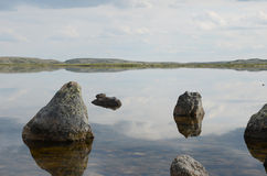 Arctic Lake. Large stones in a clean lake polar region Royalty Free Stock Images