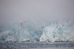 Arctic landscape - huge glacier in the fog Royalty Free Stock Image