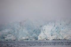 Arctic landscape - huge glacier in the fog Royalty Free Stock Image
