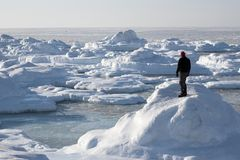 Arctic landscape, a man on the frozen fjord Stock Images
