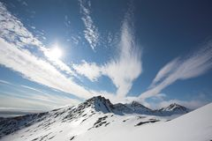 Arctic landscape - mountains. Arctic winter landscape - mountains and clouds Royalty Free Stock Image