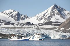 Arctic landscape - ships under the glacier. Two science ships in the Arctic Stock Photo