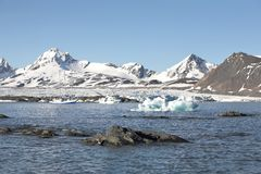 Arctic landscape - ships under the glacier. Two science ships in the Arctic Stock Image