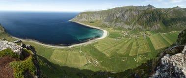 Arctic landscape: Unstad, Lofoten Islands. Unstad, Lofoten Islands, Norway. Panoramic view from Nonstinden Stock Photos
