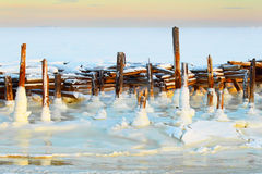 Arctic landscape. Winter. Old pier. The frozen sea. Stock Photography
