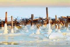 Arctic landscape. Winter. Old pier. The frozen sea. Stock Photography