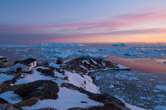 Arctic light at sunset in Ilulissat, Greenland. Midnight sun in Ilulissat, West Greenland Royalty Free Stock Image