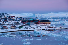 Arctic light at sunset in Ilulissat, Greenland. View of Ilulissat at sunset, West Greenland Royalty Free Stock Images