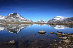 Arctic mountain lake. Reflections in an mountain lake above the polar circle Stock Images