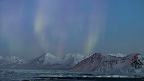 Arctic mountain landscape with Northern Lights - Spitsbergen, Svalbard stock video