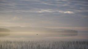 Sunrise over foggy lake Stock Image