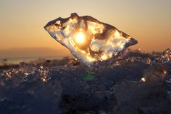 Arctic. North. The setting sun shines through the ice Stock Photography