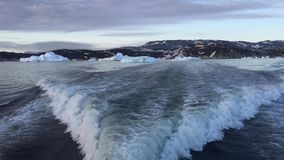 Arctic Ocean with huge icebergs. Arctic Icebergs Greenland in the arctic sea. You can easily see that iceberg is over the water surface, and below the water stock footage
