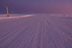 Arctic road in day time. Murmansk Region, Russia Royalty Free Stock Photos