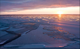 Arctic silence. Evening sunset in the Arctic Sea Stock Photo
