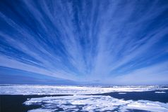 Arctic Skies. A view of the Arctic sky appearing to eminate from the distant horizon Stock Image
