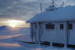 Arctic station in sunset Stock Images