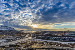 Arctic streets with houses on the rocky hills in sunset city pan Royalty Free Stock Photography