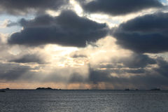 Arctic Sun rays. Sun rays betwenn the clouds on the coast of lofoten islands stock photography
