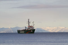 Arctic Sunrise Greenpeace. Greenpeace ship Arctic Sunrise outside Longyearbyen Svalbard, Norway. With beautiful arctic scenery in the background. The Arctic stock photography
