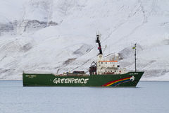 Arctic Sunrise Greenpeace. Greenpeace ship Arctic Sunrise outside Longyearbyen Svalbard, Norway. With beautiful arctic scenery in the background. The Arctic stock photos