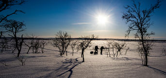 Arctic track. View on men walking in arctic landscape Royalty Free Stock Photography
