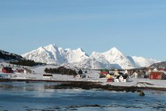 Arctic village in Lofoten. Small village in the fjord of Mortsund, Lofoten islands, in winter time Stock Photos