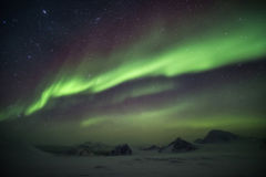 Arctic winter landscape with Northern Lights - Svalbard, Spitsbergen stock images