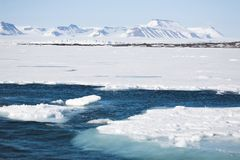 Arctic winter landscape - sea, glacier, mountains Royalty Free Stock Image