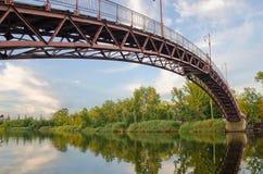 Arcuate footbridge over the River. Arcuate, a metal footbridge over the River Samara. Dnipropetrovsk region. Ukraine Royalty Free Stock Photo