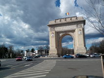 Arcul de triumf. A late afternoon view of a beautiful cloudy day in Bucharest, Romania. Indulging you in the beauty of the Arc and its blending with the entire Stock Photography