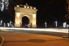 Arcul de Triumf by night in winter. Arcul de Triumf is a triumphal arch located in northen Bucharest stock photo