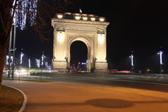 Arcul de Triumf by night in winter. Arcul de Triumf is a triumphal arch located in northen Bucharest stock photography
