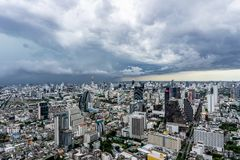 The Arcus cloud or shelf cloud storm over the downtown of Bangkok, Thailand stock photo