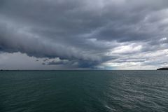 Arcus Clouds over Lake Erie. An ominous looking arcus cloud formation moving over the open waters of Lake Erie bring in a cold front royalty free stock image