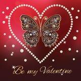 Ard con il cuore dorato delle perle e della farfalla. Fotografia Stock