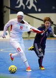 ARDALLANI Niloofar of Iran #11 and KOIDE Natsumi of Japan fight for the ball Stock Image