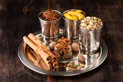 Ardamom, turmeric, cinnamon, nutmeg, star anise Royalty Free Stock Images