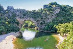 Ardeche Canyon, southern France. Vallon Pont d`Arc, Natural Rock bridge over the River in the Ardeche Canyon, southern France Stock Photo