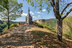 Ardennes hill with memorial statue near Village Esch-sur-Sure in Luxembourg. Ardennes hill with memorial statue and old ruin near Village Esch-sur-Sure in royalty free stock images