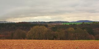 Ardennes landscape,with empty winter rfarmland and forests and hills on a cloudy day. Ardennes landscape,with empty winter farmland and forests and hills on a Stock Images
